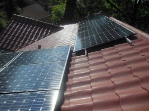 Durable metal tile style roof with solar panels mounted